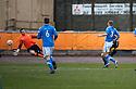 Berwick's Fraser McLaren (partially hidden behind 3) scores their first goal.