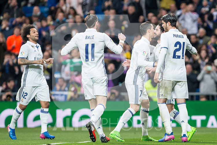 Isco Alarcon,Garet Bale, Cristiano Ronaldo and Alvaro Morata  of Real Madrid celebrates after scoring a goal during the match of Spanish La Liga between Real Madrid and UD Las Palmas at  Santiago Bernabeu Stadium in Madrid, Spain. March 01, 2017. (ALTERPHOTOS / Rodrigo Jimenez)