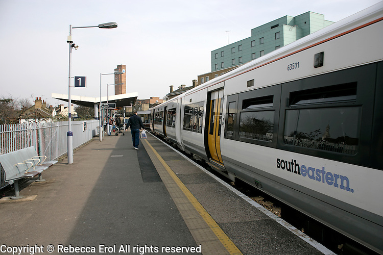 A Southeastern train at the station platform at Greenwich, London, UK