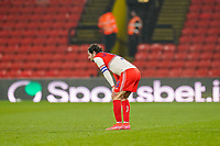 Joe Jacobson of Wycombe Wanderers looks dejected at the final whistle in the Sky Bet Championship behind closed doors match between Watford and Wycombe Wanderers at Vicarage Road, Watford, England on 3 March 2021. Photo by David Horn.