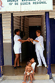 Boa Vista, Roraima State, Brazil. Two nurses at the entrance to Casa do Indio, Indian hospital.