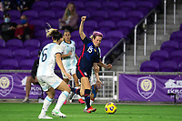 ORLANDO CITY, FL - FEBRUARY 24: Megan Rapinoe #15 of the USWNT battles for the ball during a game between Argentina and USWNT at Exploria Stadium on February 24, 2021 in Orlando City, Florida.