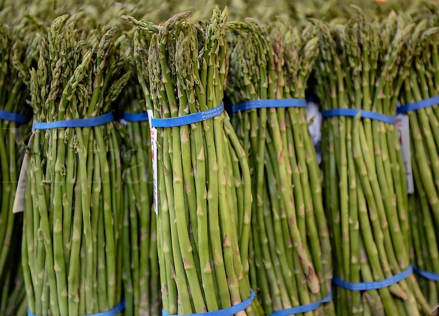 Bundles of organic asparagus in a farmers market.