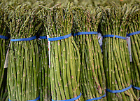 Bundles of organic asparagus in a farmers market.