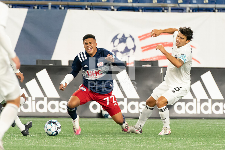 FOXBOROUGH, MA - OCTOBER 09: Damian Rivera #72 of New England Revolution II reacts to a tackle by Servando Carrasco #5 of Fort Lauderdale CF during a game between Fort Lauderdale CF and New England Revolution II at Gillette Stadium on October 09, 2020 in Foxborough, Massachusetts.