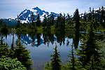 Washington, Mt. Baker National Park. Mt. Shuksan reflected in a lake in mid summer.