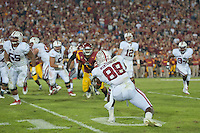 LOS ANGELES, CA - October 29, 2011:  Tyler Montgomery catches an Andrew Luck pass on the hook and lateral play in the first overtime period during Stanford's victory over the USC Trojans.  Tyler lateralled to Jeremy Stewart (34, far right).   Stanford won in triple overtime, 56 -48, and extended its winning streak to 16 games.