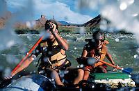 Couple (MR) river rafting on the Colorado River, near Moab, UT. Moab, Utah.