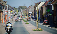 peloton cruising through town<br /> <br /> 55th Brabantse Pijl 2015