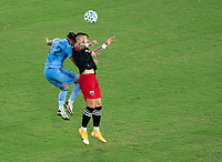 WASHINGTON, DC - SEPTEMBER 06: Ronald Matarrita #22 of New York City FC goes up for a header with Ulises Segura #8 of D.C. United during a game between New York City FC and D.C. United at Audi Field on September 06, 2020 in Washington, DC.