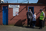 Home fans entering the ground via a turnstile at Palmerston Park, Dumfries before Queen of the South hosted Dundee United in a Scottish Championship fixture. The home has played at the same ground since its formation in 1919. Queens won the match 3-0 watched by a crowd of 1,531 spectators.