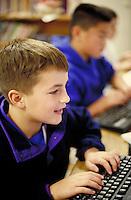 ELEMENTARY SCHOOL COMPUTER LAB. ELEMENTARY STUDENTS. OAKLAND CALIFORNIA USA CARL MUNCK ELEMENTARY SCHOOL.