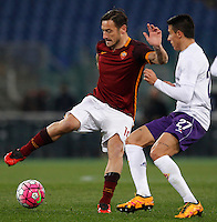 Calcio, Serie A: Roma vs Fiorentina. Roma, stadio Olimpico, 4 marzo 2016.<br /> Roma's Francesco Totti, left, is challenged by Fiorentina's Cristian Tello during the Italian Serie A football match between Roma and Fiorentina at Rome's Olympic stadium, 4 March 2016.<br /> UPDATE IMAGES PRESS/Riccardo De Luca