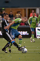 Antonio Ribeiro (l) and Freddie Ljungberg (r) fight for the ball in the Seattle Sounders 2-1 win against San Jose Earthquake on Saturday, June 13, 2009 at Quest Field in Seattle, WA.