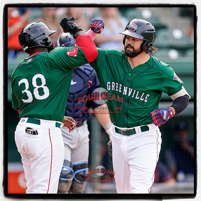 Devlin Granberg (26), right, of the Greenville Drive celebrates his home run with Tyreque Reed (38) in a game against the Bowling Green Hot Rods on Sunday, May 9, 2021, at Fluor Field at the West End in Greenville, South Carolina. (Tom Priddy/Four Seam Images)