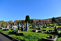 Pictured: A general view of Treorchy Cemetery in south Wales, UK.<br /> Re: A funeral mourner fell into an 8ft grave and had to be rescued by firemen.<br /> Grieving relatives watched in horror as the man in his sixties slipped and fell backwards into the open grave.<br /> Undertakers tried to pull him out but it was too deep and a 999 call was made.<br /> Firemen rescued him after he spent 20 minutes in the grave dug for his loved one's final resting place at Treorchy Cemetery, Rhondda, South Wales.<br /> He was gently lifted out using support straps and transferred to an ambulance.