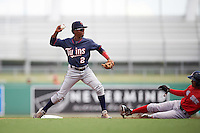 Minnesota Twins Gorge Munoz (2) throws to first as Lorenzo Cedrola (44) slides in during an Instructional League game against the Boston Red Sox on September 23, 2016 at JetBlue Park at Fenway South in Fort Myers, Florida.  (Mike Janes/Four Seam Images)