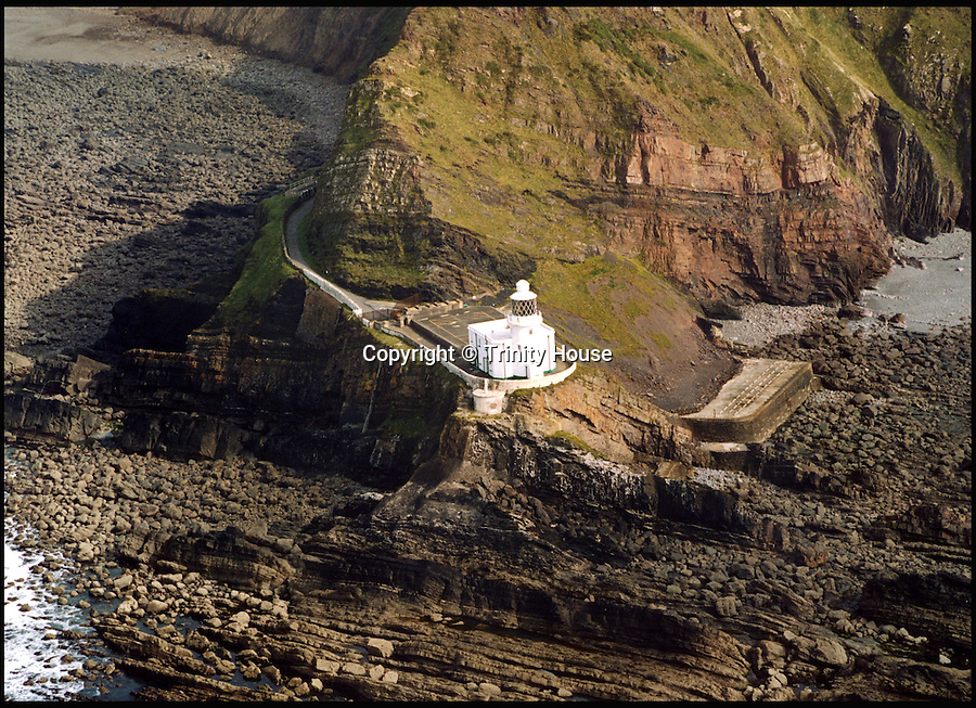 BNPS.co.uk (01202 558833)<br /> Pic: TrinityHouse/BNPS<br /> <br /> A stunning 19th century lighthouse perched on a rocky outcrop near one of the country's top holiday destinations has gone on the market for £450,000.<br /> <br /> For more than a century Hartland Point Lighthouse guided ships past the north Devon coast but now it's up for grabs giving buyers a chance to turn it into a spectacular seaside home.<br /> <br /> The stunning 60ft high lighthouse is on a remote headland near the resort town of Bideford - and is so secluded that it can only be accessed by a rugged coastal path.