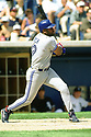 CHICAGO - CIRCA 1996:  Joe Carter #29 of the Toronto Blue Jays bats during an MLB game at Comiskey Park in Chicago, Illinois. Carter played for 16 seasons with 6 different teams and was a 5-time All-Star. (David Durochik / SportPics) --Joe Carter