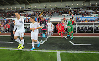 Pictured: Team captain for Swansea Leon Britton and Scott Flinders of York come out of the tunel Tuesday 25 August 2015<br /> Re: Capital One Cup, Round Two, Swansea City v York City at the Liberty Stadium, Swansea, UK.