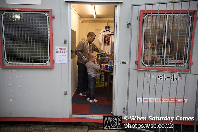 Prestatyn Town 0 Port Talbot Town 0, 19/10/2013. Bastion Gardens, Welsh Premier League. A man and boy buying refreshments from the tuck shop at Bastion Gardens during during half-time of the match between Prestatyn Town and visitors Port Talbot Town in the Welsh Premier League. Prestatyn Town were Welsh Cup winners in 2013. The match ended goalless and was watched by 211 spectators. Photo by Colin McPherson.