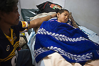 PK Teo from Safata village lies injured and frightened in Apia hospital. More than 170 people died when a tsunami triggered by an 8.3 magnitude earthquake hit Samoa and neighbouring Pacific islands on 29/09/2009. Samoa (formerly known as Western Samoa)..