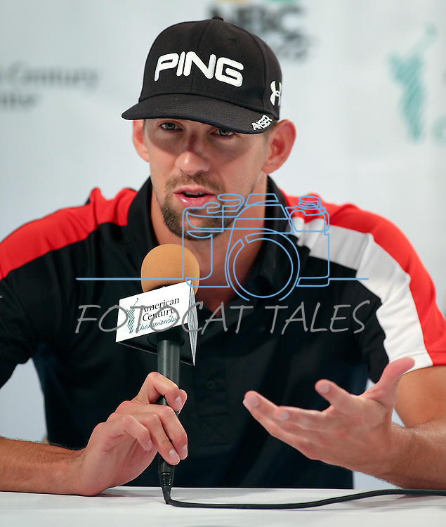 Olympic gold medalist Michael Phelps speaks at a press conferece before a practice round in the American Century Celeb-Am Tournament at Edgewood Tahoe in Stateline, Nev., on Thursday, July 18, 2013.<br /> Photo by Cathleen Allison