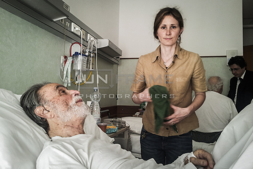 Mere gives support to her father, hospitalized in the cardiac  care unit for recursive heart problems