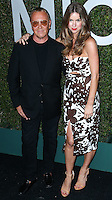 BEVERLY HILLS, CA, USA - OCTOBER 02: Michael Kors, Claiborne Swanson Frank arrive at Michael Kors Launch Of Claiborne Swanson Franks's 'Young Hollywood' Book held at a Private Residence on October 2, 2014 in Beverly Hills, California, United States. (Photo by Xavier Collin/Celebrity Monitor)