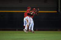 AZL Reds outfielders Rafael Franco (back), Wendell Marrero (31), and Fidel Castro (17) celebrate a victory after an Arizona League game against the AZL Athletics Green on July 21, 2019 at the Cincinnati Reds Spring Training Complex in Goodyear, Arizona. The AZL Reds defeated the AZL Athletics Green 8-6. (Zachary Lucy/Four Seam Images)