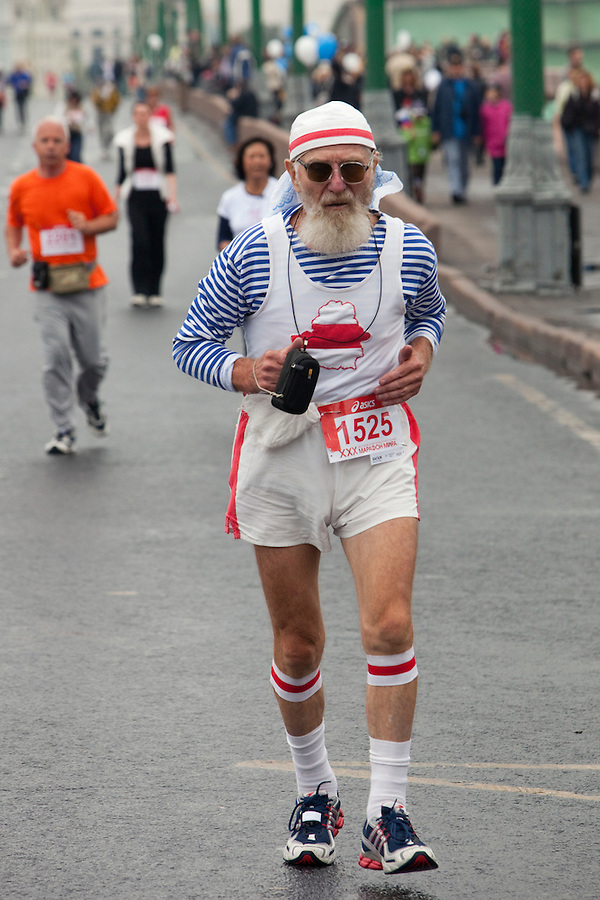 Moscow, Russia, 12/09/2010..An elderly runner makes his way across a bridge during the 30th annual Moscow International Marathon.