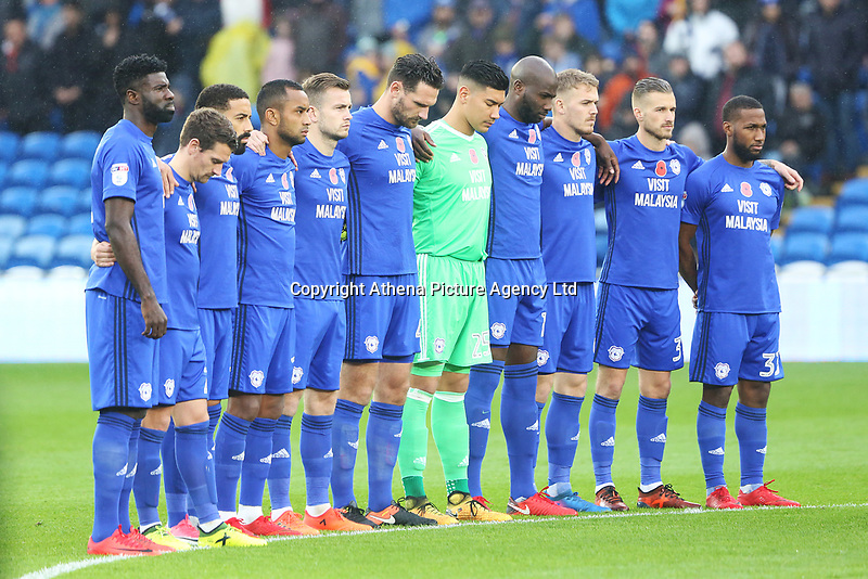 The Cardiff City team line up to observe a minutes silence prior to kick off of the Sky Bet Championship match between Cardiff City and Brentford at the Cardiff City Stadium, Wales, UK. Saturday 18 November 2017