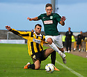 Hibs' Callum Crane gets away from Kevin Smith.