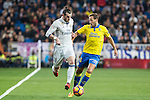 Garet Bale of Real Madrid competes for the ball with Dani Castellano of UD Las Palmas during the match of Spanish La Liga between Real Madrid and UD Las Palmas at  Santiago Bernabeu Stadium in Madrid, Spain. March 01, 2017. (ALTERPHOTOS / Rodrigo Jimenez)