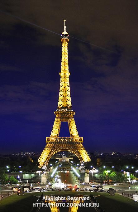 Eiffel (Eifel) tower by night illuminated with dramatic sky