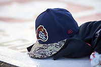 A Peoria Chiefs hat rests on the dugout during a Midwest League game against the Bowling Green Hot Rods at Dozer Park on May 5, 2019 in Peoria, Illinois. Peoria defeated Bowling Green 11-3. (Zachary Lucy/Four Seam Images)