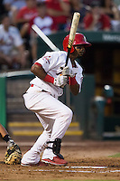Ruben Gotay (18) of the Springfield Cardinals follows through his swing after making contact on a pitch during a game against the Northwest Arkansas Naturals at Hammons Field on August 23, 2013 in Springfield, Missouri. (David Welker/Four Seam Images)