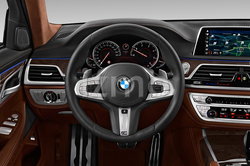 Car pictures of steering wheel view of a 2018 BMW 7 Series M Sport 4 Door Sedan
