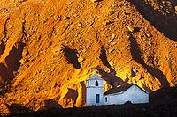 Sunset on San Isidro Church (open once a year!) in Catarpe Valley, at the foot of the red Atacama Desert rocks, near San Pedro de Atacama, Chile