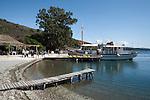Greece, Corfu, Agios Stefanos: Tourist boat docked in village on North East coast of Island