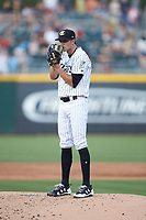 Charlotte Knights starting pitcher Spencer Adams (18) looks to his catcher for the sign against the Toledo Mud Hens at BB&T BallPark on June 22, 2018 in Charlotte, North Carolina. The Mud Hens defeated the Knights 4-0.  (Brian Westerholt/Four Seam Images)