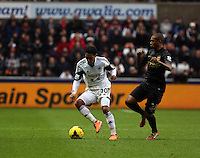 Wednesday, 01 January 2014<br /> Pictured L-R: Jonathan de Guzman of Swansea against Fernandinho of Manchester City. <br /> Re: Barclay's Premier League, Swansea City FC v Manchester City at the Liberty Stadium, south Wales.