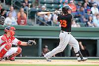 First baseman Christian Walker (23) of the Delmarva Shorebirds in a game against the Greenville Drive on  Friday, April 26, 2013, at Fluor Field at the West End in Greenville, South Carolina. Walker played for the National Champion University of South Carolina Gamecocks. He is listed as the No. 12 prospect of the Baltimore Orioles, according to Baseball America. He was a fourth-round draft pick in 2012. (Tom Priddy/Four Seam Images)