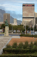 South Africa, Cape Town.  Statue of Bartholomew Diaz in Traffic Circle.  Adderley Street in Background.