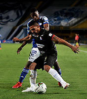 BOGOTA - COLOMBIA, 17-12-2020: Emerson Rodriguez de Millonarios F. C. y David Gomez de Once Caldas disputan el balon, durante partido entre Millonarios F. C. y Once Caldas de la Semifinales por la Liguilla BetPlay DIMAYOR 2020 jugado en el estadio Nemesio Camacho El Campin de la ciudad de Bogota. / Emerson Rodriguez of Millonarios F. C. and David Gomez of Once Caldas figth for the ball, during a match between Millonarios F. C. and Once Caldas of the Semifinals for the BetPlay DIMAYOR 2020 Liguilla played at the Nemesio Camacho El Campin Stadium in Bogota city. / Photo: VizzorImage / Luis Ramirez / Staff.