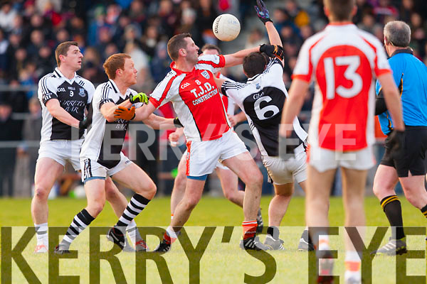 Dave Curtin Brosna fights  for posession of the loose ball with  Glin's Philip Moloney, Edmond Horan and Jack Fitzgerald  during the Munster junior final in mallow on Sunday