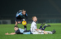 Adam Campbell of Notts County gives a foul away to Matt Bloomfield of Wycombe Wanderers as Michael Harriman of Wycombe Wanderers holds onto the ball during the Sky Bet League 2 match between Wycombe Wanderers and Notts County at Adams Park, High Wycombe, England on 15 December 2015. Photo by Andy Rowland.