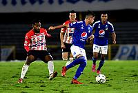 BOGOTA - COLOMBIA, 23-10-2021: Daniel Ruiz de Millonarios y Luis Gonzalez de Atletico Junior disputan el balon durante partido entre Millonarios F. C. y Atletico Junior de la fecha 15 por la Liga BetPlay DIMAYOR II 2021 jugado en el estadio Nemesio Camacho El Campin de la ciudad de Bogota. / Daniel Ruiz of Millonarios F. C. and Luis Gonzalez of Atletico Junior figth for the ball during a match between Millonarios F. C. and Atletico Junior of the 15th date for the BetPlay DIMAYOR II 2021 League played at the Nemesio Camacho El Campin Stadium in Bogota city. / Photo: VizzorImage / Luis Ramirez / Staff.