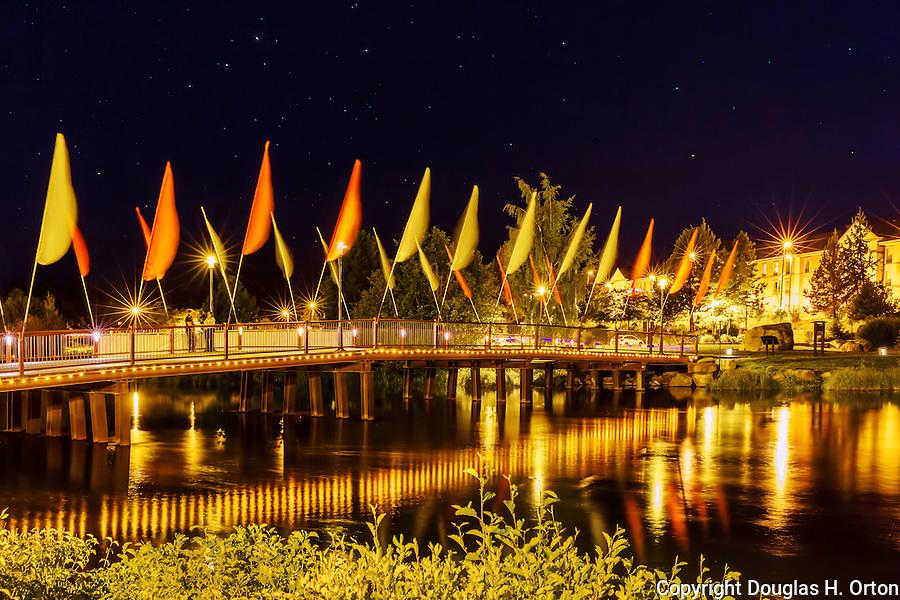Night view of Deschutes River pedestrian bridge through Bend, Oregon.  Clear night with stars shinning.