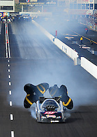 Feb. 20, 2010; Chandler, AZ, USA; NHRA funny car driver Terry Haddock smokes after blowing an engine during qualifying for the Arizona Nationals at Firebird International Raceway. As a result of the explosion Haddock was disqualified from the event. Mandatory Credit: Mark J. Rebilas-
